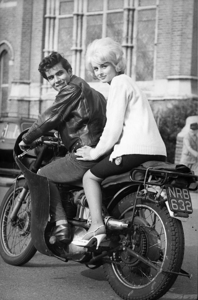 7th October 1962:  Sixteen year old Pamela Brown and her eighteen year old boyfriend, Nigel Hudson, on his motorbike before their wedding.  (Photo by Norman Potter/Express/Getty Images)
