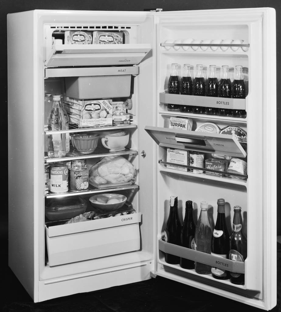 7th July 1966:  A fully stocked refrigerator, filled with Bird's Eye frozen meals and bottles of drink.  (Photo by Chaloner Woods/Getty Images)
