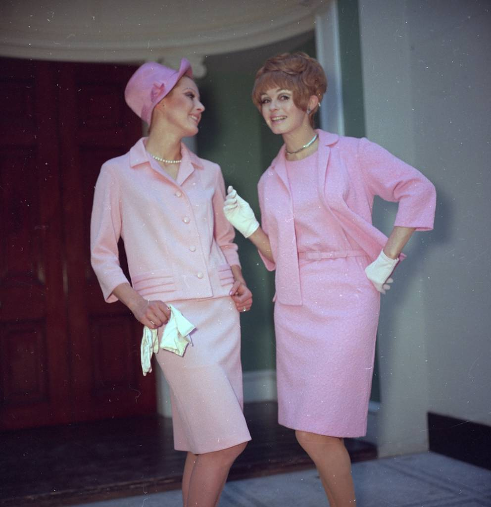 7th July 1969:  Two ladies both dedicated followers of fashion  wear pale pink outfits and chat about how fabulous life is.  (Photo by Chaloner Woods/Getty Images)