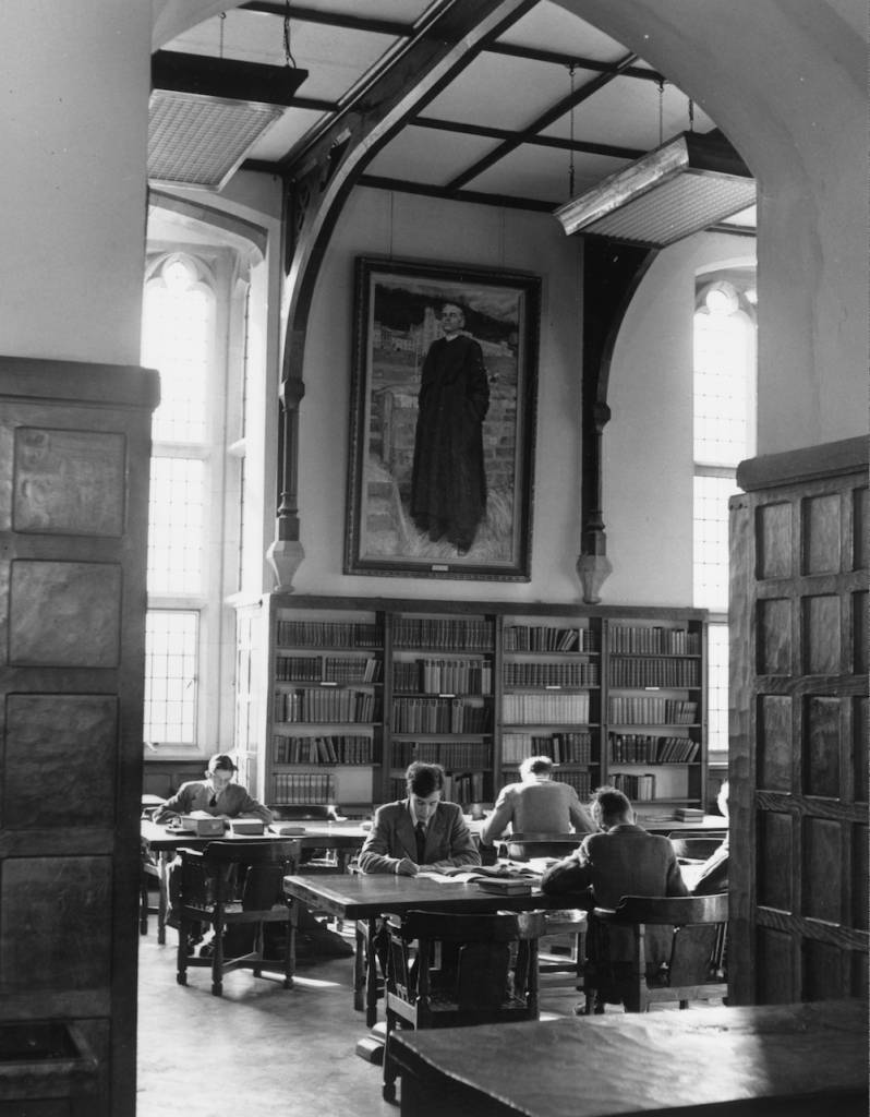 14th March 1952: Pupils studying in the library at Ampleforth College in Yorkshire under a large portrait of a monk hanging on the wall. Ampleforth is a Roman Catholic public school run by Benedictine monks. (Photo by Keystone Features/Getty Images)