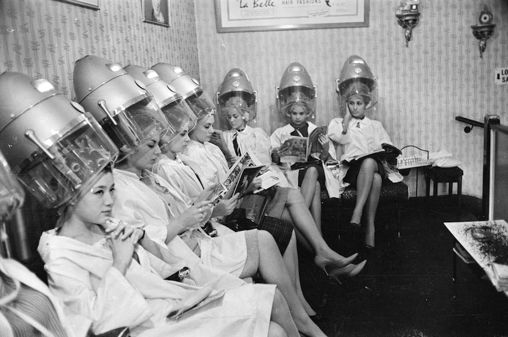 7th November 1963:  Miss World Contestants visit a hairdresser before the big event.  (Photo by Terry Fincher/Express/Getty Images)