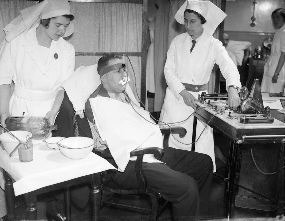 7th July 1936:  A hay fever patient undergoing electrical treatment at the University College Hospital. The affected mucous membrane is treated with zinc ions.  (Photo by Harry Todd/Fox Photos/Getty Images)
