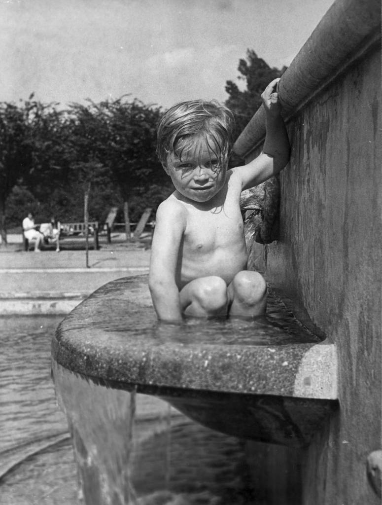 7th June 1950:  A young child cooling off in a fountain at the Jardin D'Acclimatation in Paris.  (Photo by Keystone/Getty Images)