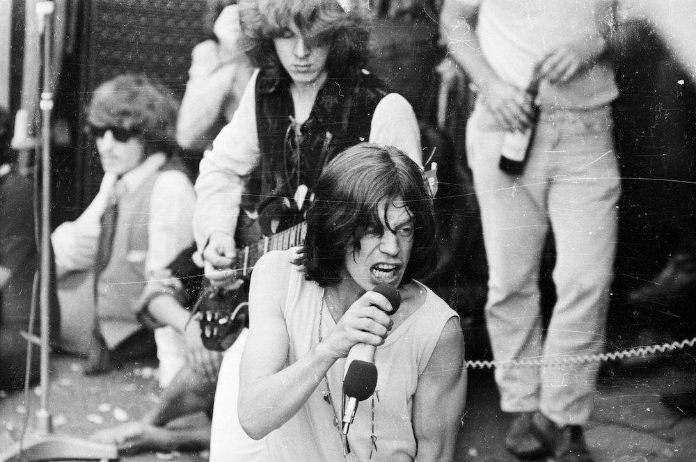 5th July 1969: Vocalist Mick Jagger and guitarist Mick Taylor in concert with the Rolling Stones in London's Hyde Park. The free outdoor concert was a tribute to recently deceased band member Brian Jones. (Photo by Reg Burkett/Express/Getty Images)