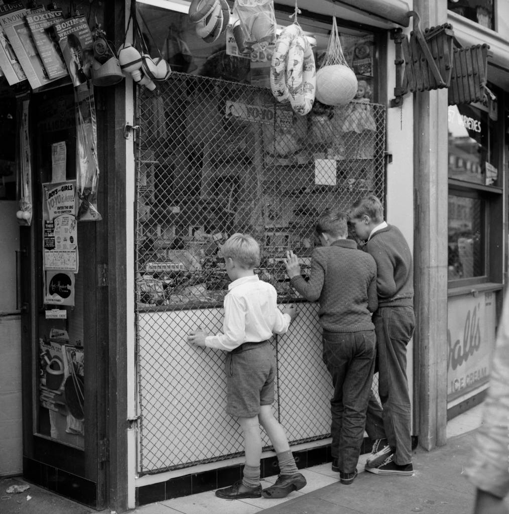 7th September 1962:  Three young boys gazing at toys in a shop window in old Walworth Street, home of the East Street Market, south London. The market is soon to be replaced with the modern Elephant and Castle shopping precinct.  (Photo by Chris Ware/Keystone Features/Getty Images)