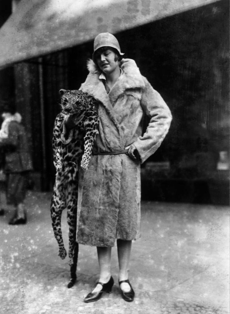 1928: A young woman with the latest in fur fashion, which is to carry the whole stuffed fur of the animal. They give a lifelike effect and are said to be particularly useful as motoring muffs. (Photo by London Express/Getty Images)