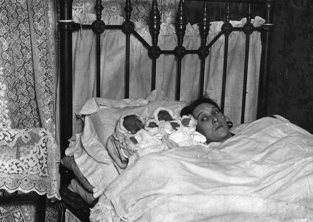 1st March 1924:  Mrs Trewin with two of the quads who survived from birth.  (Photo by Hulton Archive/Getty Images)
