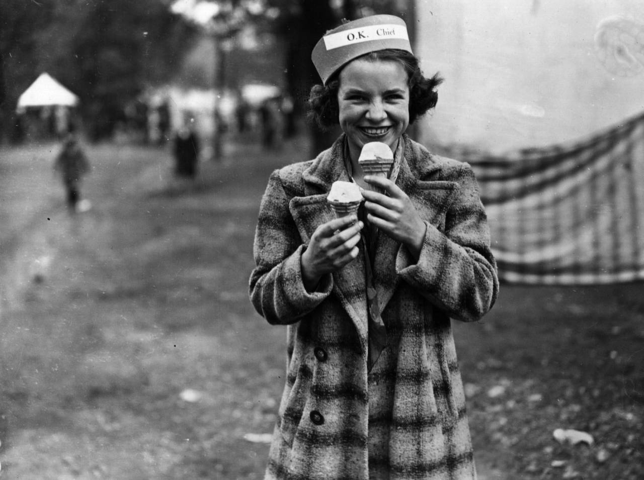 7th August 1939:  Eating two ices at once, or perhaps one is for her friend?  (Photo by Topical Press Agency/Getty Images)