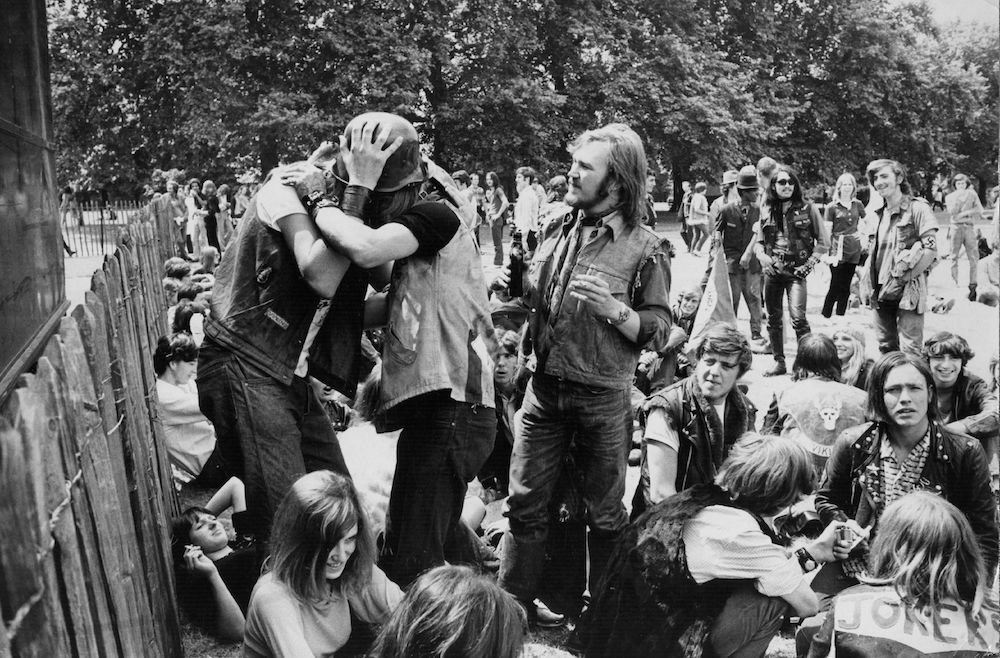 21st July 1970: Hell's Angels kissing at a free pop concert held in Hyde Park, London in 1970. (Photo by Evening Standard/Getty Images)