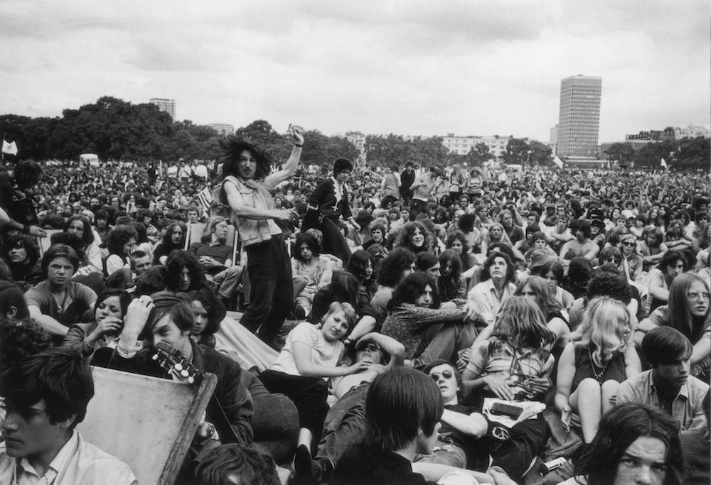 21st July 1970: An exuberant fan at a free concert in Hyde Park performs an impromptu dance amidst the crowd. (Photo by Evening Standard/Getty Images)