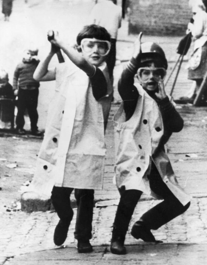12th August 1971: A view of two children in the crowded market area of Belfast re-enacting the shooting of four men the day before. (Photo by Central Press/Getty Images)