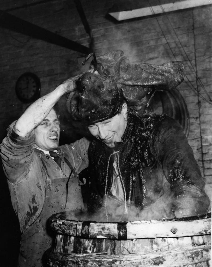 7th March 1958:  Young Stanley George, of Essex, undergoes the traditional initiation ceremony for an apprentice to a 'Journeyman Cooper'.  (Photo by Ron Burton/Keystone/Getty Images)