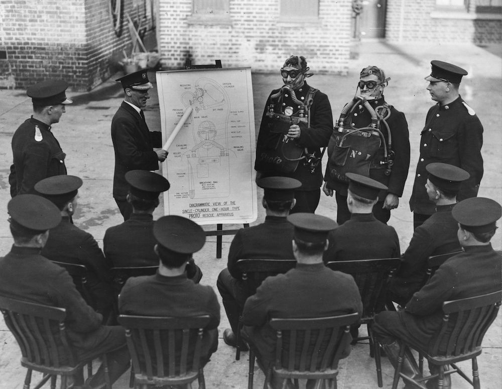 7th February 1934:  A fire-fighting class being given by the Brighton Fire Brigade.  (Photo by Fox Photos/Getty Images)