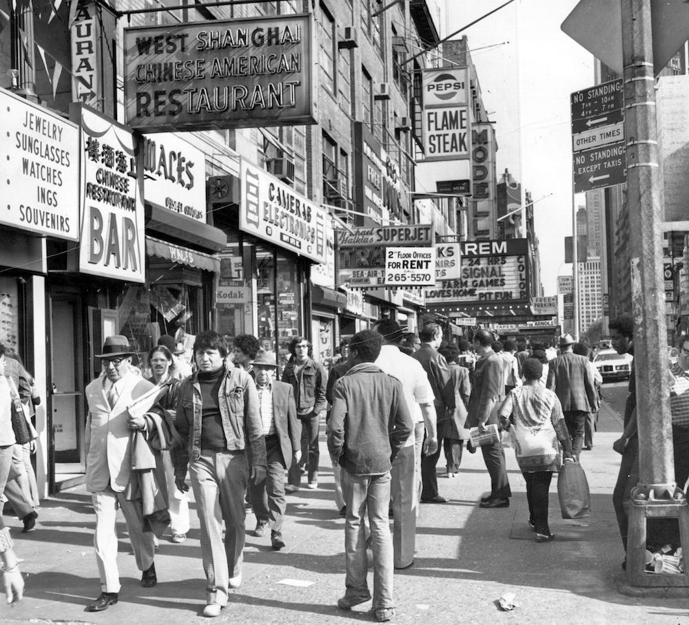12th October 1975:  Shoppers on West 42nd Street between 7th and 8th Avenues in the Times Square area of New York.  (Photo by Peter Keegan/Keystone/Getty Images)