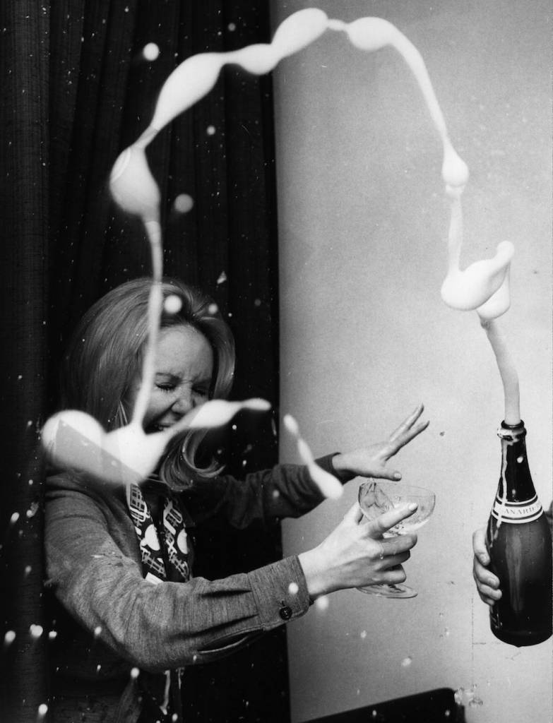 7th April 1970:  Glasgow born pop singer Lulu (Marie MacDonald McLaughlin Lawrie) celebrates with champagne after hearing she will help host a TV show in America.  (Photo by Central Press/Getty Images)