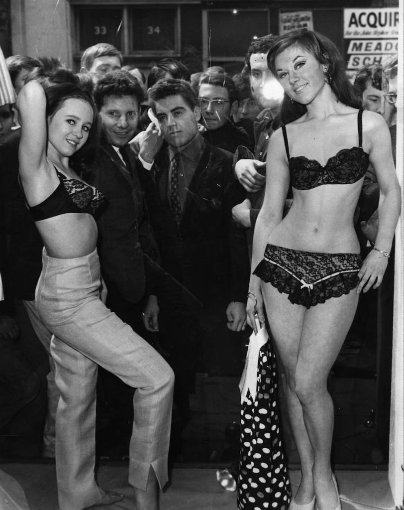 12th May 1966: Carnaby Street shop owner Henry Moss attracted crowds by hiring scantily-clad models to pose as mannequins in his window. (Photo by Keystone/Getty Images)