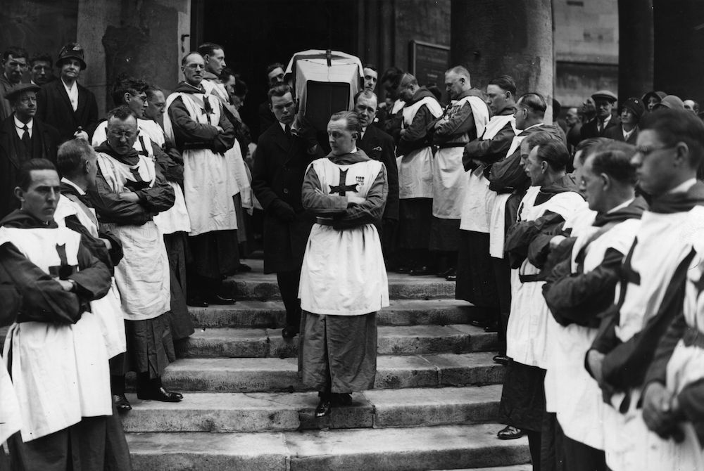 7th May 1931:  The coffin of the late Dr Weir, the famous pathologist, being carried from All Souls Church, Langham Place. The steps were lined by members of the Order of Crusaders of which Dr Weir was a member.  (Photo by Hulton Archive/Getty Images)