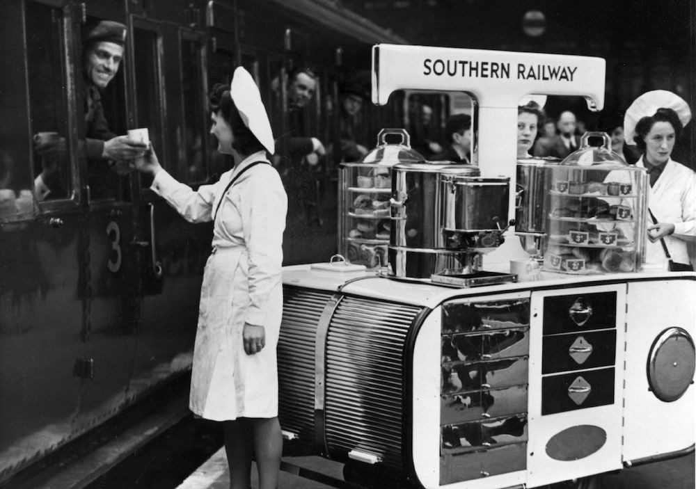 1st March 1946:  One of the Southern Railway's new tea trolleys in service at Waterloo Station, London. It carries enough hot water for 300 cups of tea, as well as having cake racks and ice cream cabinets.  (Photo by Fox Photos/Getty Images)