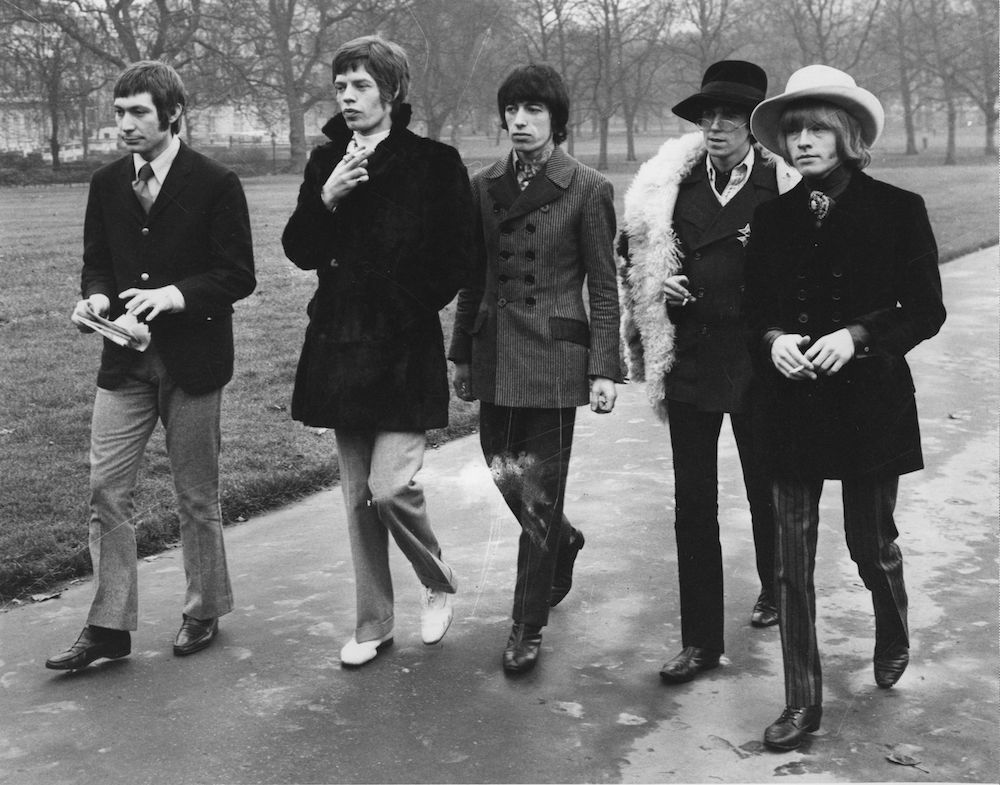 11th January 1967: The Rolling Stones walking in London's Green Park prior to their visit to the United States to appear on the Ed Sullivan show. They are, from left to right; Charlie Watts, Mick Jagger, Bill Wyman, Keith Richards and Brian Jones (1944 - 1969). (Photo by Keystone/Getty Images)