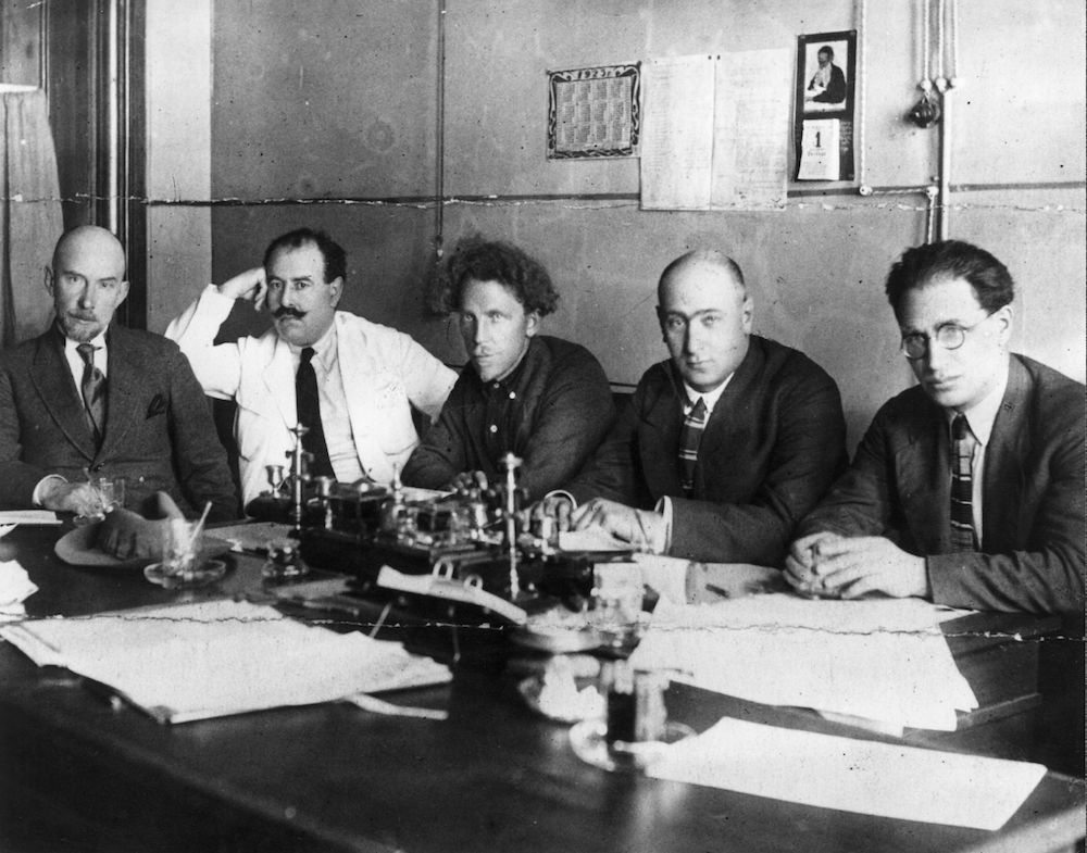 1st March 1924:  Alex Krasnoshenekov, Stalin's brother-in-law Lazar Moiseyvich Kaganovitch,  Hodrov, Golyatkin and Gomberg at a meeting of the board of the Moscow Stock Exchange.  (Photo by Hulton Archive/Getty Images)