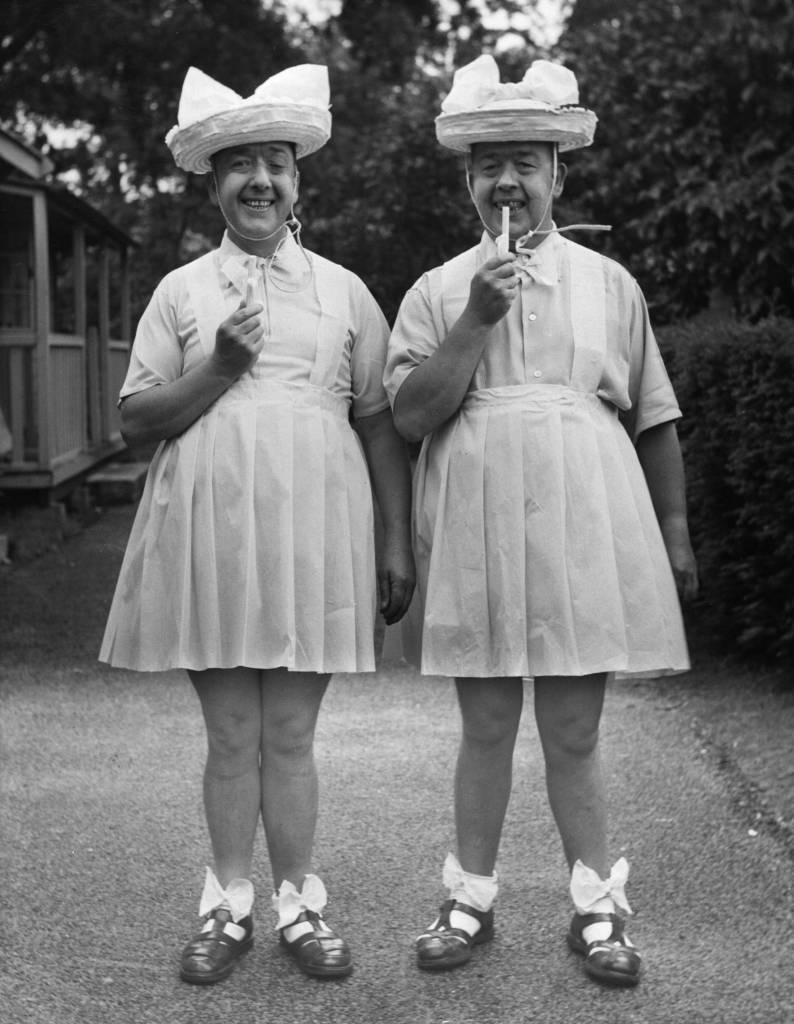 7th August 1953:  The Hardy twins entered the Tune Title contest at Gunton Hall Holiday Camp, near Lowestoft, dressed as 'Two Little Girls in Blue', and won first prize.  (Photo by Fox Photos/Getty Images)