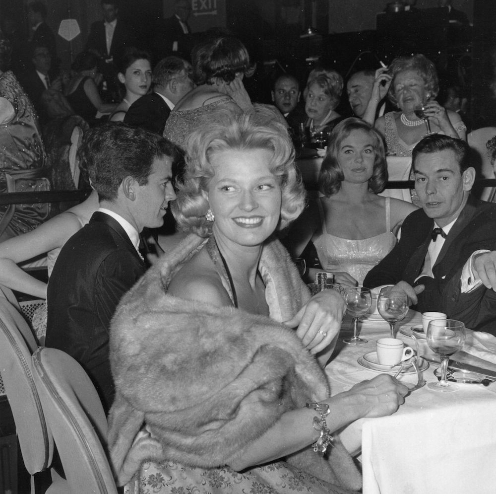 29th March 1961: All eyes are on singer Joan Regan as she dines out at the 'Talk of the Town' restaurant in London. (Photo by Evening Standard/Getty Images)