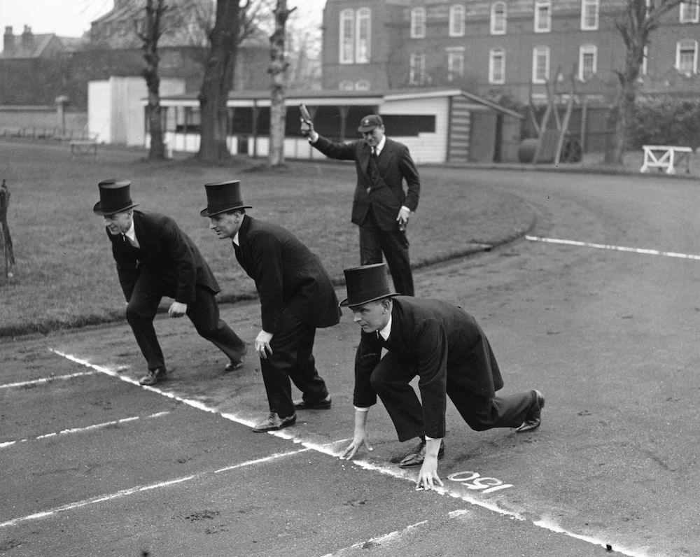 7th March 1936:  Cambridge policemen, known as 'Bulldogs', lined up for the University Bulldogs Chase, dressed in morning coats and top hats.  (Photo by H. Allen/Topical Press Agency/Getty Images)