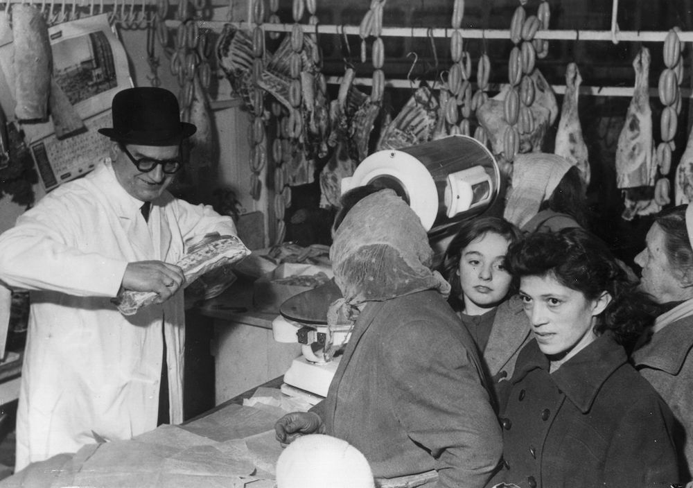 9th January 1960: Butcher Charles Oswald Lee, a ?250,000 Pools winner, makes good his promise to give free meat to his customers at his butcher's shop in Birmingham. (Photo by Keystone/Getty Images)
