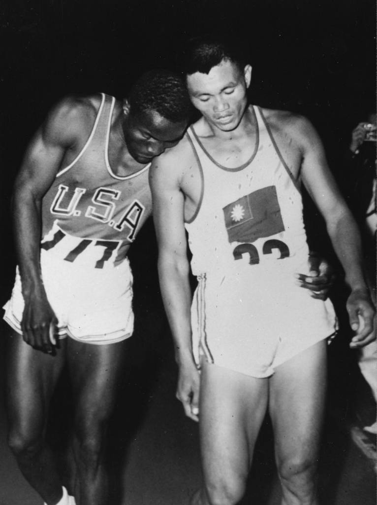 7th September 1960:  American athlete Rafer Johnson (left) and Yang Chuan-Kwang of Taiwan together after completing the 1500 metres event of the decathlon at the 1960 Rome Olympics. Johnson went on to win the decathlon with Yang in second place.  (Photo by Keystone/Getty Images)
