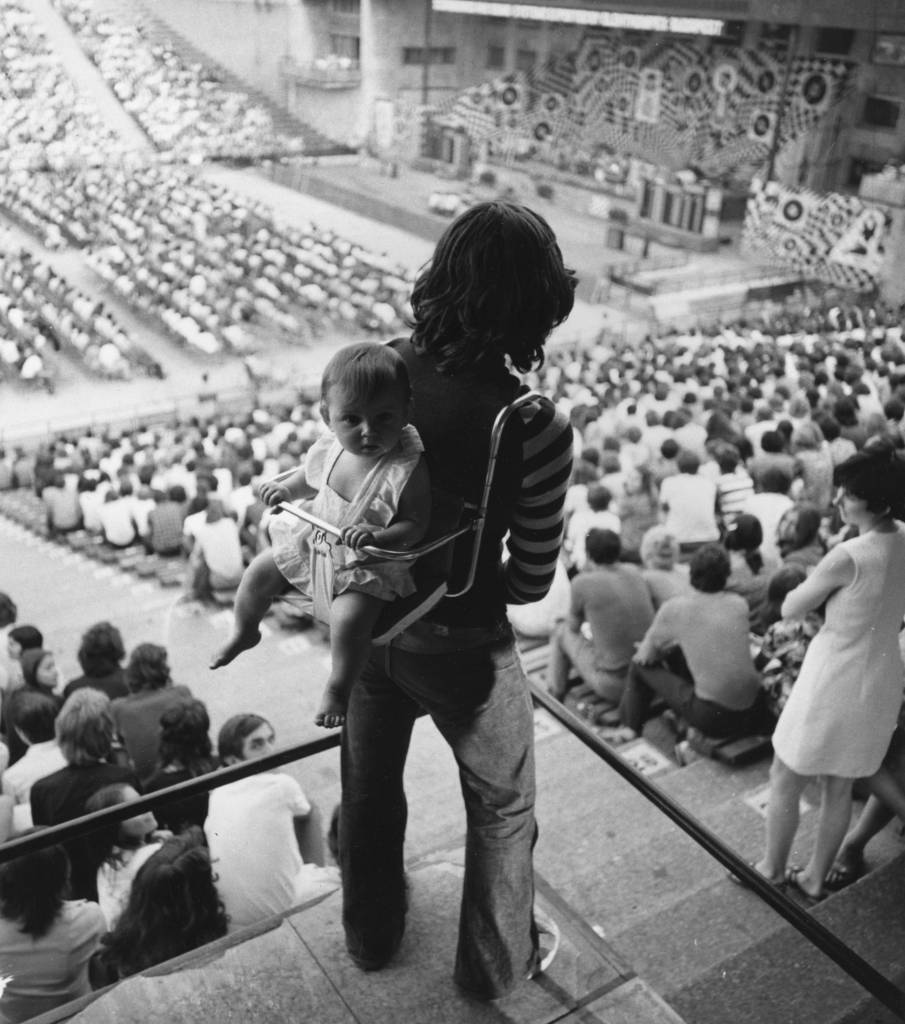 7th August 1973:  A young fan on her father's back at a concert by leading Hungarian pop singer Zsuzsa Koncz.  (Photo by Keystone/Getty Images)