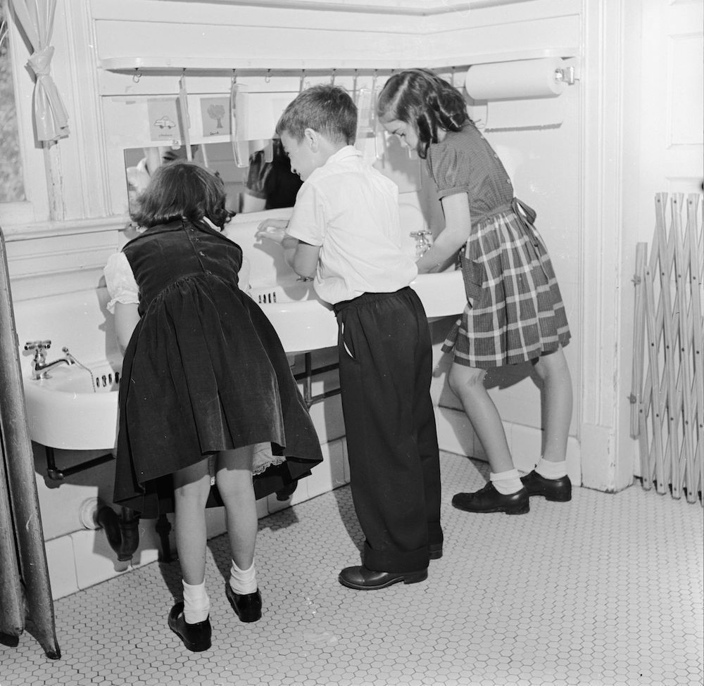 circa 1948: Children wash before lunch at Westchester County School of the Association for the Help of Retarded Children, the first parent-sponsored non-profit school in New York State. (Photo by Orlando /Three Lions/Getty Images)