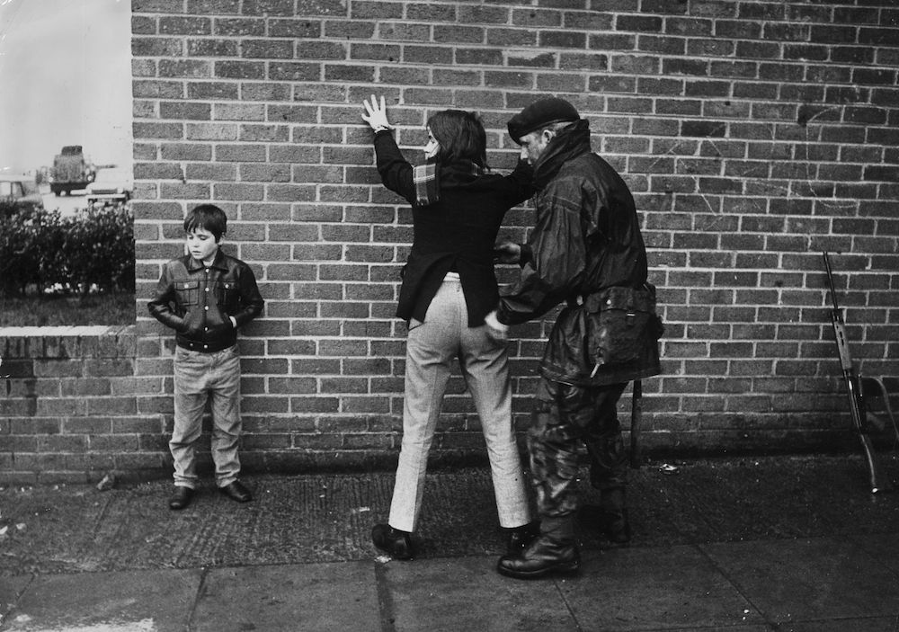 1971: A British soldier searching a Belfast teenager. (Photo by Keystone/Getty Images)