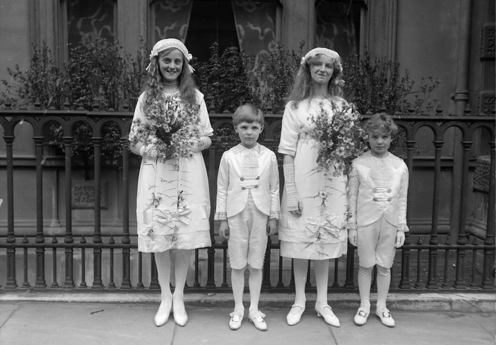 7th May 1913:  Bridesmaids and pages at a society wedding held at Christ Church. L to R Miss Pamela Cobbold, Master Ralph Cobbold, Miss Angela Toillemaste and Master J Folbett.  (Photo by Topical Press Agency/Getty Images)