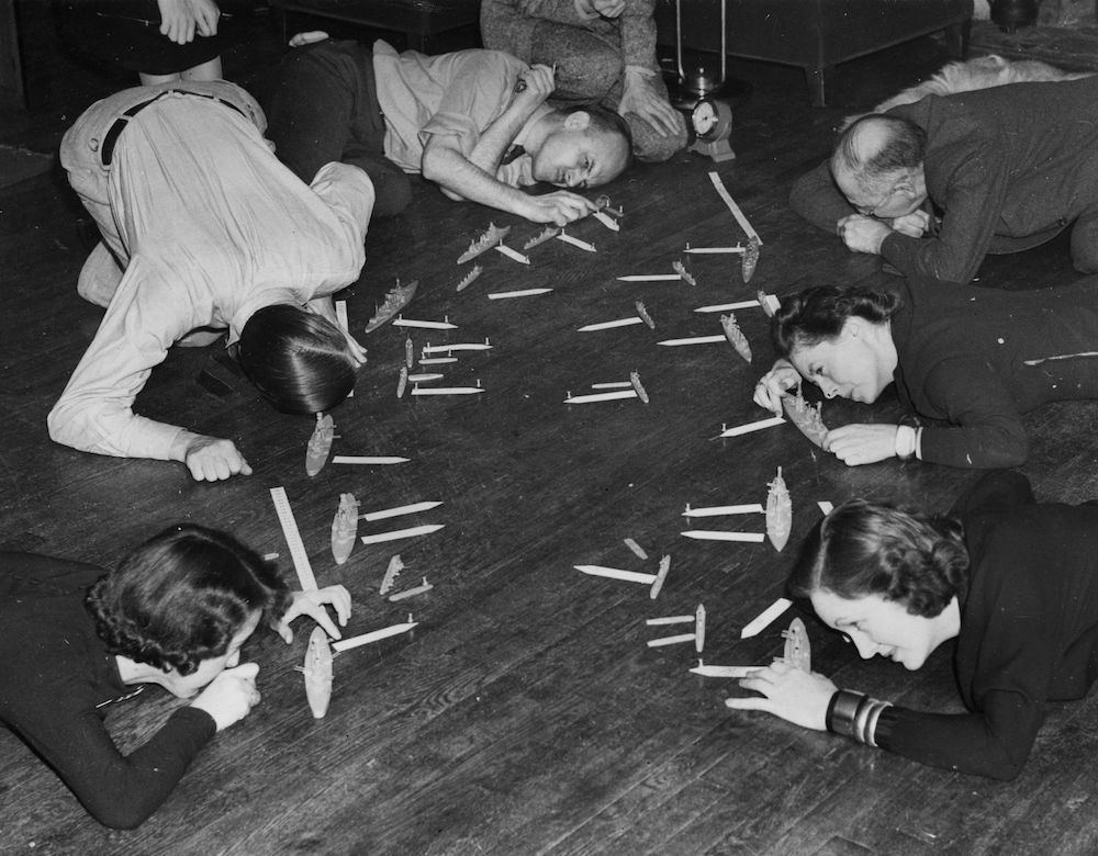 7th November 1938:  Game players at the home of New York author Fletcher Pratt, who has devised a naval game called Pratt's War Game, based on intricate mathematical formulas.  (Photo by Fox Photos/Getty Images)