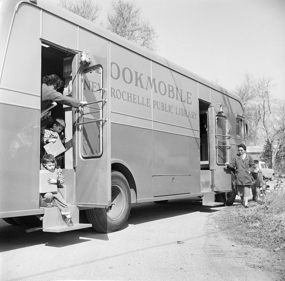 circa 1955: An American 'Bookmobile' mobile library with children leaving it as another customer arrives in a residential area of New Rochelle, New York State. (Photo by Vecchio/Three Lions/Getty Images)