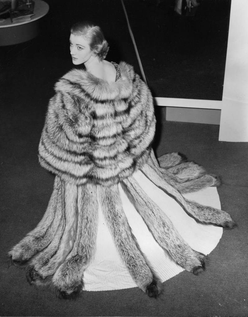 3rd May 1954: Sheila Symonds wearing a cape of Canadian Pearl Platinum mink fur at the British Industries Fair in London. (Photo by Meager/Fox Photos/Getty Images)