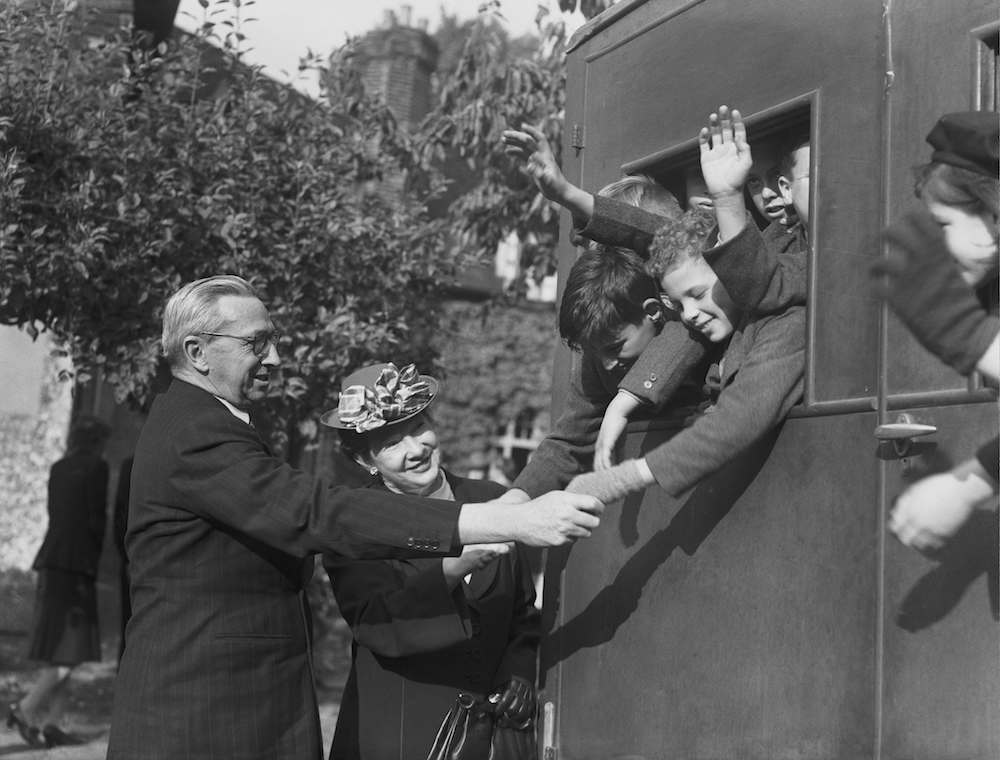 7th October 1947:  A group of orphaned children from the Dr Barnardo's Garden City, Woodford Bridge, Essex, en route to a new life in Australia being seen off by the deputy High Commissioner for Australia, Mr Norman Mighell.  (Photo by Fred Morley/Fox Photos/Getty Images)
