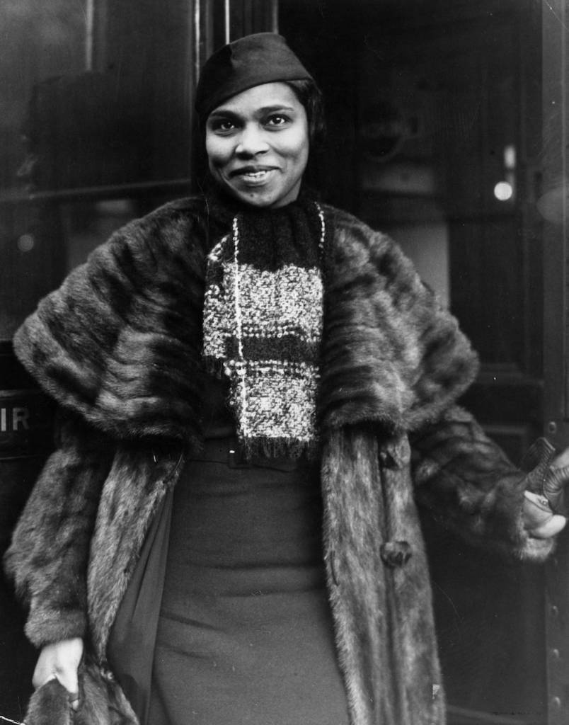 16th November 1936: American opera singer Marian Anderson (1897 - 1993), the first black singer to perform at the New York Metropolitan Opera House, on her arrival in London for a concert at the Queen's Hall. (Photo by General Photographic Agency/Getty Images)