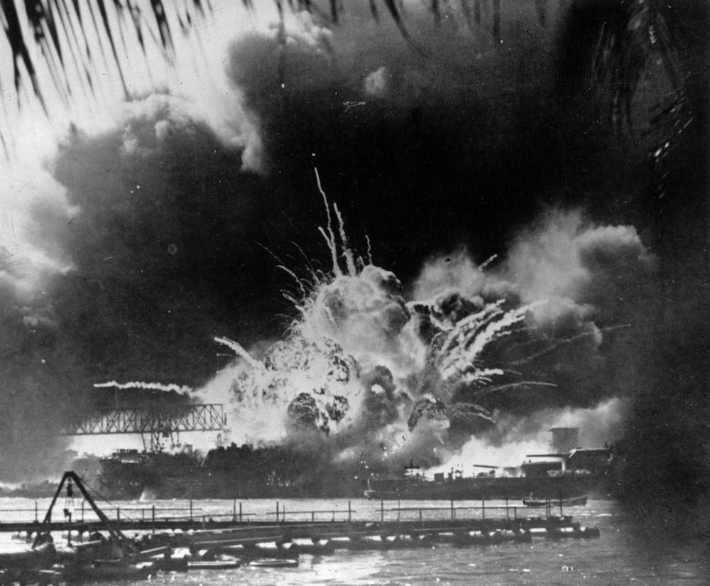 7th December 1941:  The USS Shaw exploding during the Japanese attack on the US Pacific fleet at their base in Pearl Harbour (Pearl Harbor) on the island of Oahu, Hawaii.  (Photo by Keystone/Getty Images)
