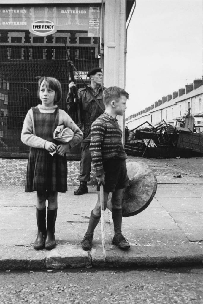 17th August 1969: A British soldier stands on patrol at a street corner in Belfast, while two children mount their own kerbside guard. (Photo by Wesley/Keystone/Getty Images)