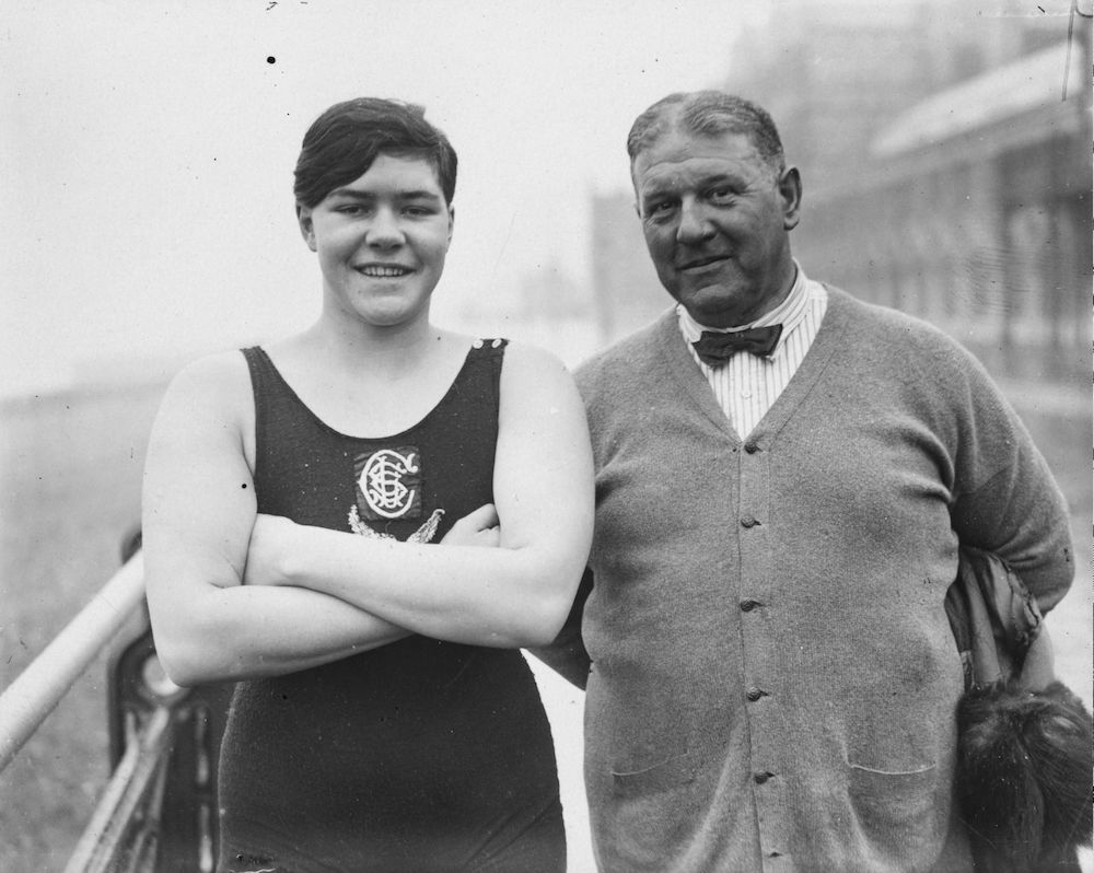 7th February 1930:  South African swimmer Patricia Retief with coach Jabez Wolffe. Sixteen years old and weighing over 12 stone Miss Retief is in England to try and swim the Channel.  (Photo by E. F. Corcoran/Topical Press Agency/Getty Images)
