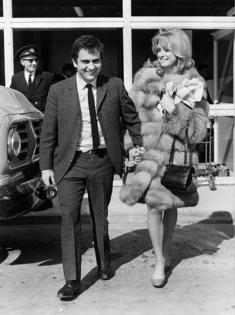 18th March 1966: The comedian Dudley Moore (1935 - 2002) and actress Suzy Kendall at Heathrow Airport, London. (Photo by Evening Standard/Getty Images)
