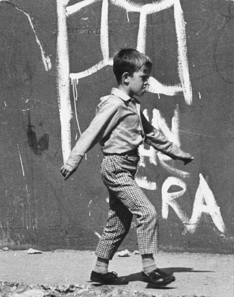 28th October 1971: A young boy walking past nationalist graffiti in Ulster. (Photo by Fulvio Grimaldi/Keystone Features/Getty Images)