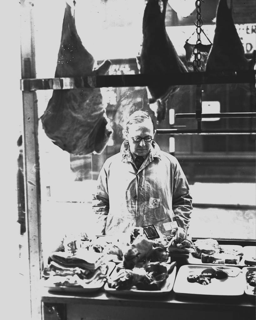 1938: Morley Richards gazing at meat on display in a butcher's shop window. (Photo by London Express/Getty Images)