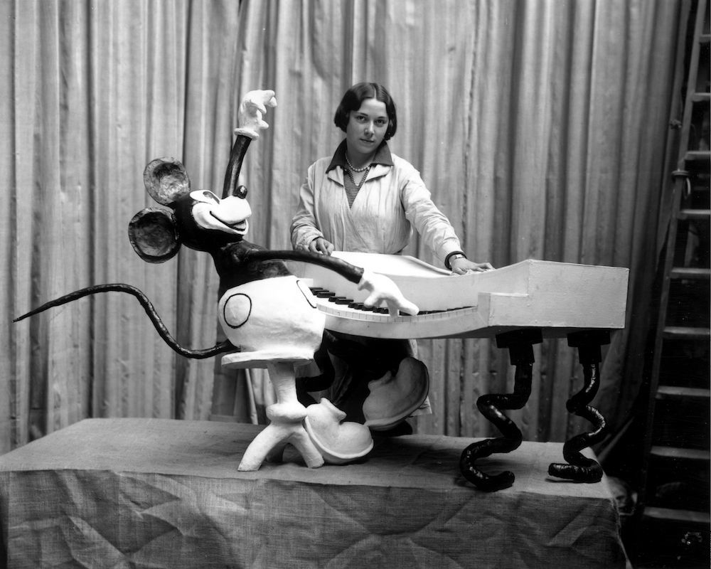 7th November 1930:  An employee at Madame Tussaud's waxworks museum on Marylebone Road, London, putting the finishing touches to a waxwork of Mickey Mouse at the keyboard.  (Photo by Douglas Miller/Topical Press Agency/Getty Images)