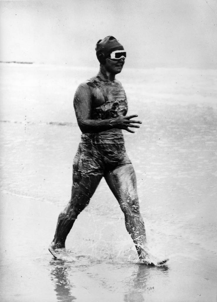 7th August 1926:  American Olympic gold medalist, swimmer Gertrude Ederle enters the water for her cross-Channel swim.  (Photo by General Photographic Agency/Getty Images)