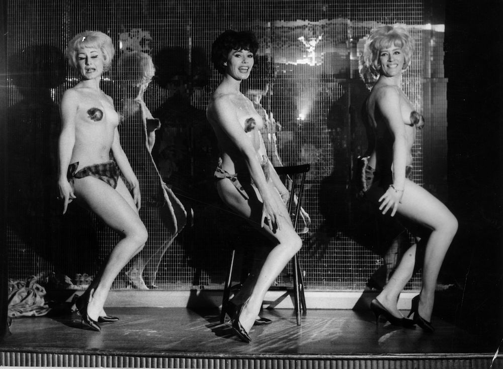 January 1963: Dressed in miniscule fur bikinis, Kean Fluffles, Angela Parker and Audrey Crane, three of the glamorous girls performing in London's Casino de Paris in London's Soho. (Photo by John Pratt/Keystone Features/Getty Images)