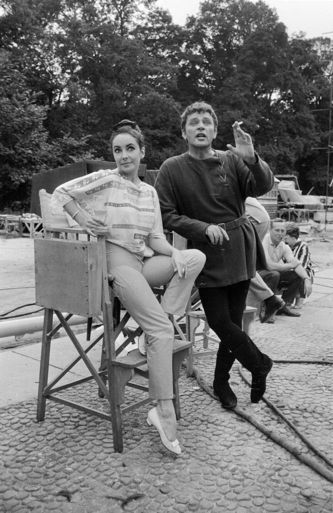 7th August 1963:  Welsh actor Richard Burton (1925 - 1984) with his co-star Elizabeth Taylor on the set of 'Becket' at Shepperton Studios, Middlesex.  (Photo by Harry Dempster/Express/Getty Images)