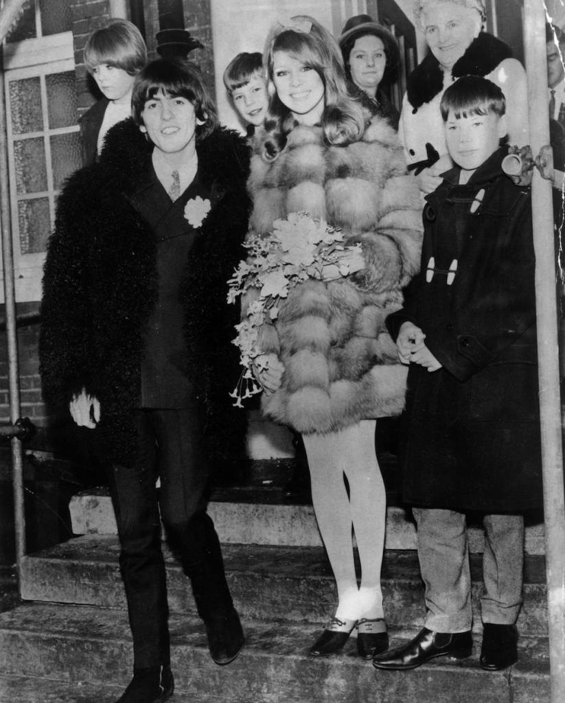 24th January 1966: Beatles guitarist George Harrison (1943 - 2001) and his bride, 21 year old model Patti Boyd, leaving Epsom Registry Office, London, after their marriage. (Photo by Evening Standard/Getty Images)