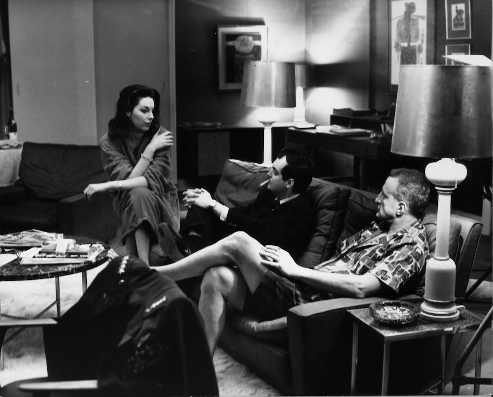7th March 1963:  Actors Tracy Reed and George C Scott take time off the set of 'Dr Strangelove', being filmed at Shepperton Studios, for a discussion with director Stanley Kubrick. The film's full title is 'Dr Strangelove: Or How I Learned To Stop Worrying And Love The Bomb'.  (Photo by Keystone/Getty Images)